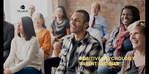 Parents in classroom at a seminar.