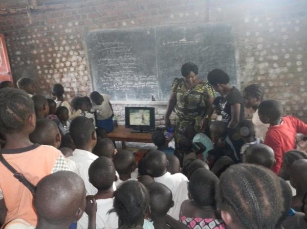 Bahati Valerie, COFAPRI founder, shows a DVD