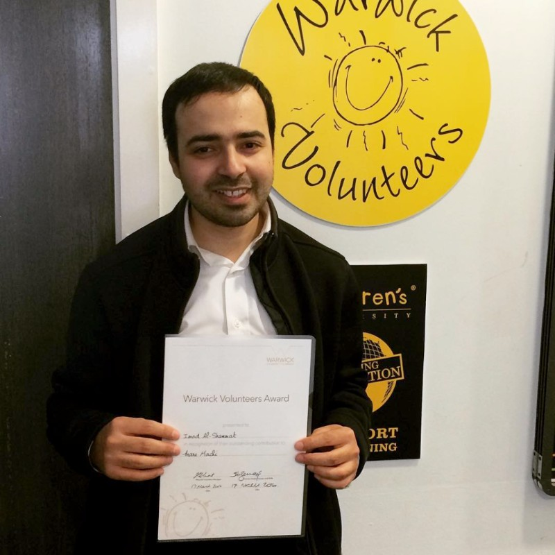 Imad with his certificate