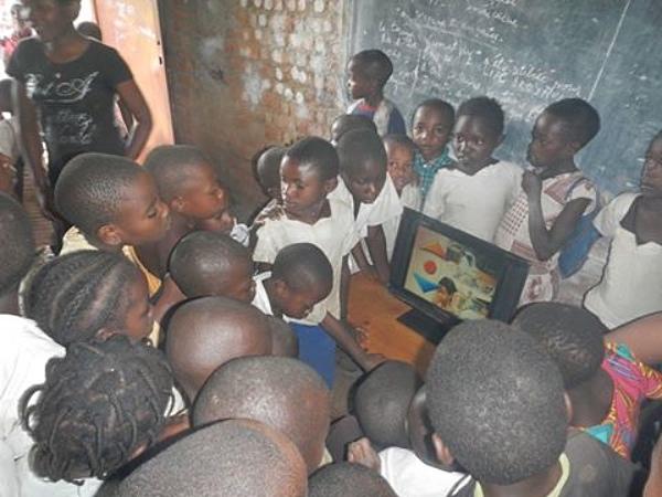 Children in DRC watch a DVD