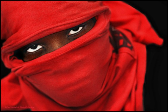 """One of Carl Juste's photos,""""The Mask"""": A man wearing a red t-shirt as a mask. Photo by Carl Juste"""