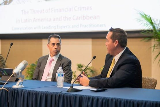 Kenneth Blanco, head of the financial crimes unit of the U.S. Department of the Treasury, listens as Brian Fonseca, director of the Jack D. Gordon Institute for Public Policy, speaks during an event on financial crimes in Latin America.