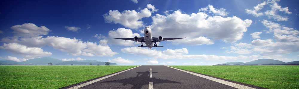 image of plane landing on runway