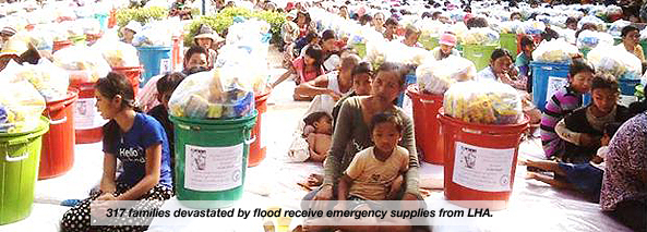 317 families devastated by flood receive emergency supplies from LHA.