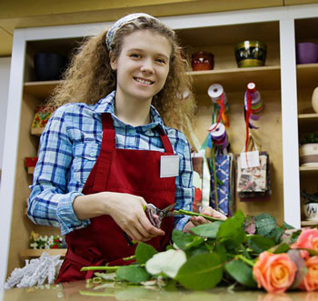 Girl at work clipping flowers
