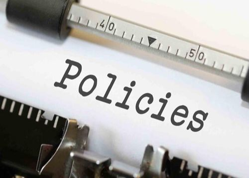 Policies on a piece of paper in a type writer