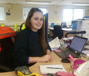 Civil engineer Tara at her desk in the office