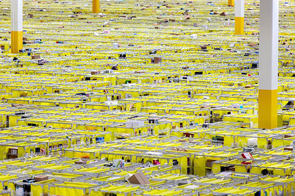 Shelves with product are organized and moved around by robots inside of the Amazon Fulfillment Center in New Jersey