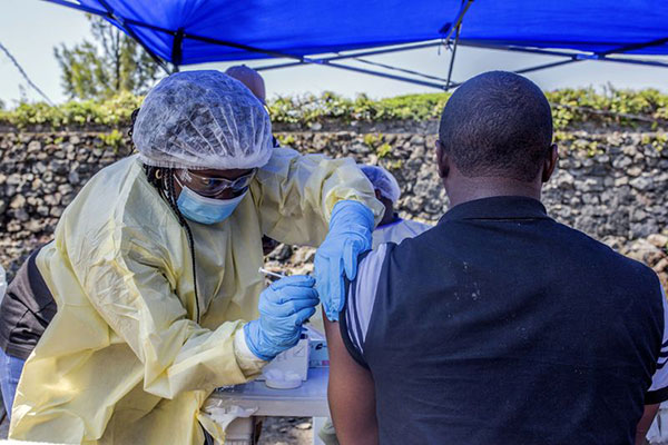 A man receives a vaccine against Ebola from a nurse in Goma.