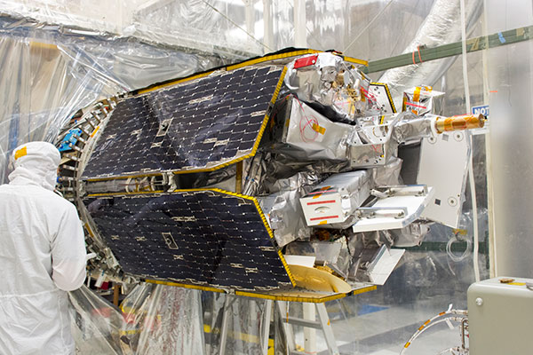 ICON is attached to its Pegasus XL rocket inside a clean room at Vandenberg Air Force Base in California.