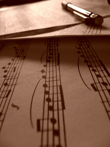 Sheet music and pen