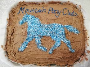 Brown cake with blue writing