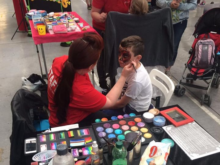 Child getting a makeover into a ladybug!