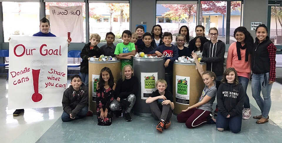 Photo of Student Leadership Team collecting food.