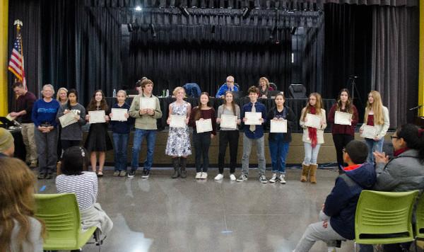 Photo of students receiving award at Board Meeting