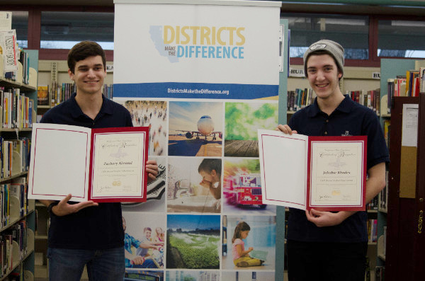 Photo of student video contest winners receiving award