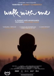 Film Poster with silhouette of a monk's head and shoulders with back turned to us with sky skrapers blurry and visible in the far distance in a setting sun.