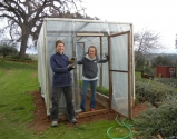 DAMAS WWoofers helping with the greenhouse