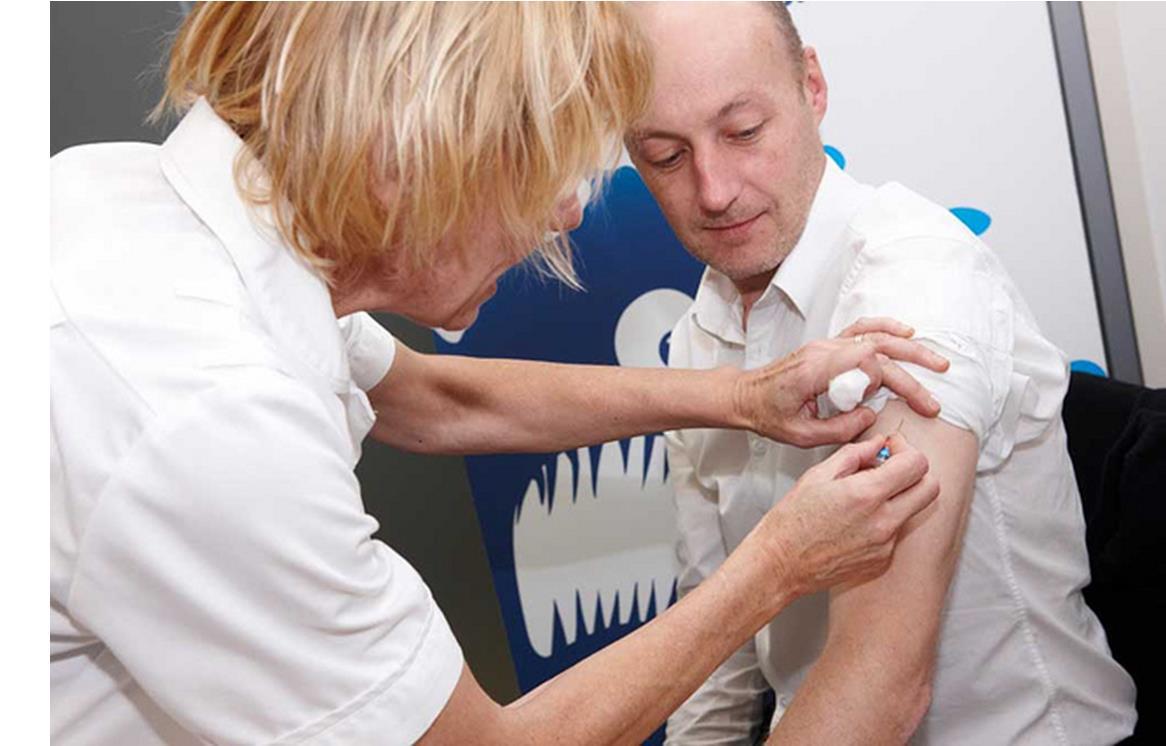 Man having a flu jab