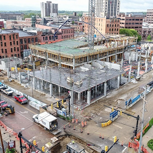 Seven-story mixed-use building under construction.