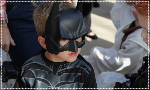 Child dressed as Batman Role-play afternoon tea