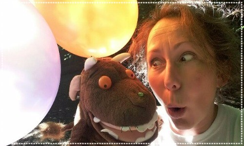 lady with Gruffalo puppet and balloons
