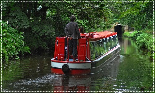Man on canal boat