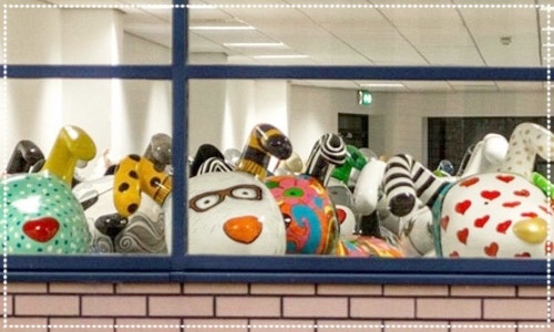 Snowdogs looking out of a window Farewell Party