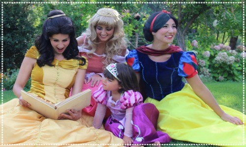 PRINCESSES READING TO GIRL
