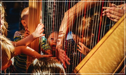 Harpist & children playing the Harp