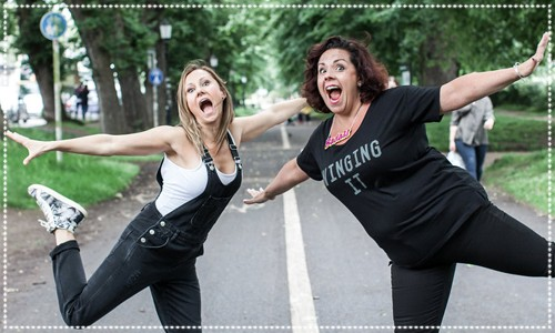 Two mums striking fun flying poses