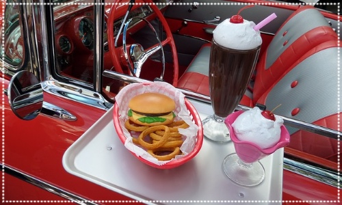 Drive in cinema at Bents Park. Image is of a fifties style car and food