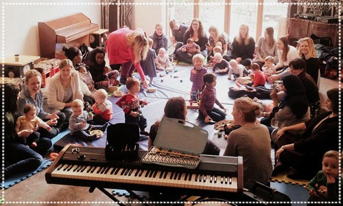 Group of parents & children enjoying music