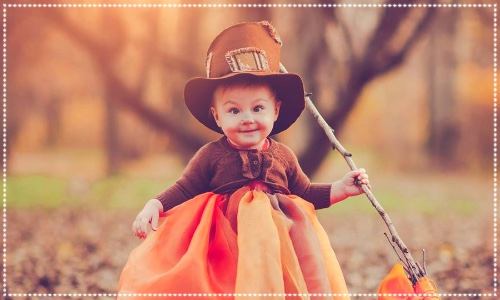 Kids pumpkin party at Wynyard hall. Baby dressed in orange outfit and hat