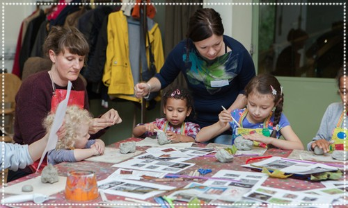 A group of children & adults making arts and crafts