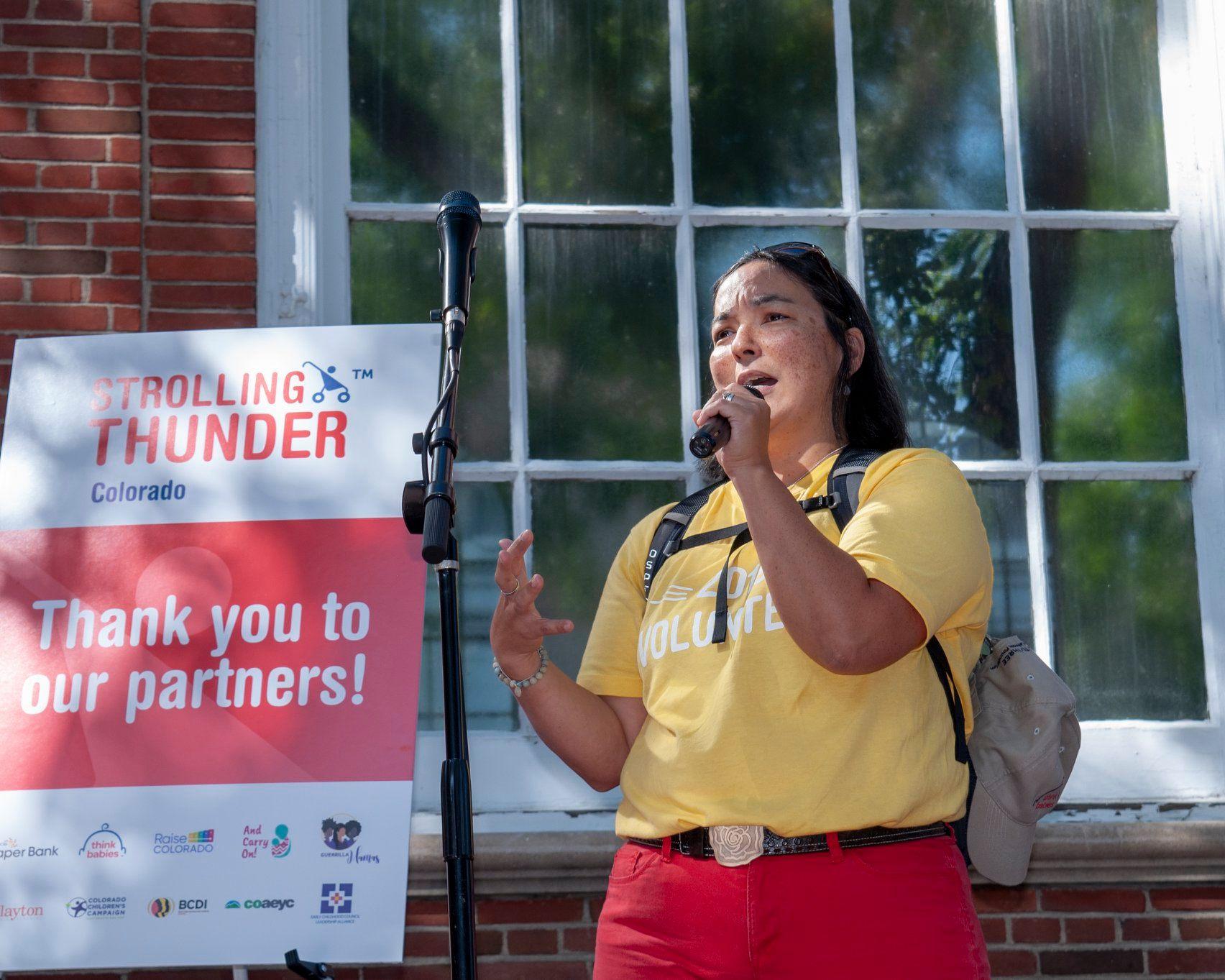 COAEYC Past Chair Akane Orlandella Ogren speaking at Strolling Thunder, September 21st, 2019 photo by Aaron Leavy