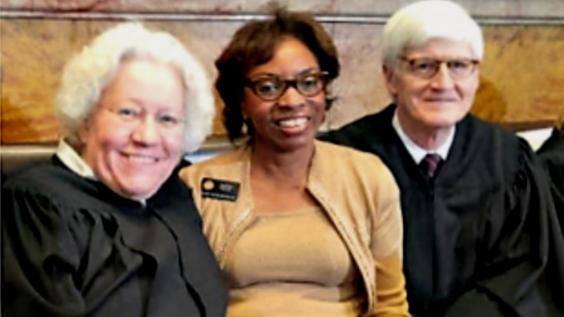 Colorado Supreme Court Chief Justice Nancy Rice, Rep. Rhonda Fields and Justice Nathan Coats.