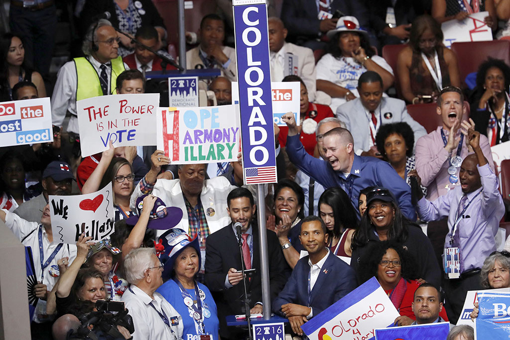 Colorado Democratic Party Chairman Rick Palacio delivers Colorado's roll call vote for Bernie Sanders and Hillary Clinton on the convention floor yesterday, surrounded by the delegation. (AP photo)