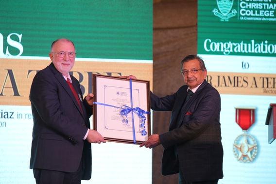 Dr. James Tebbe is presented the Sitara-e-Imtiaz Award