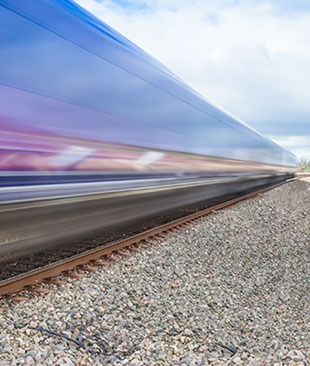 A motion blur of a train whizzing by