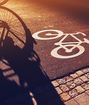 Cycle path symbol with a bike shadow across it