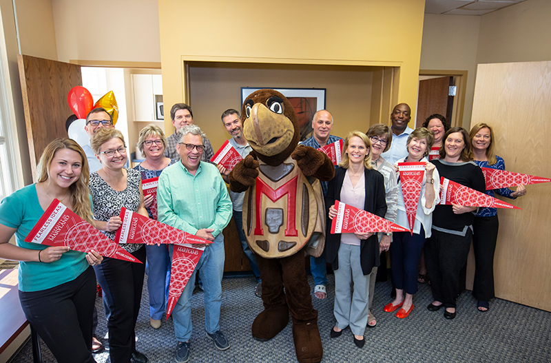 COE faculty and staff pose with Testudo for campaign launch
