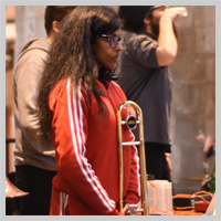Young woman getting ready to play trombone