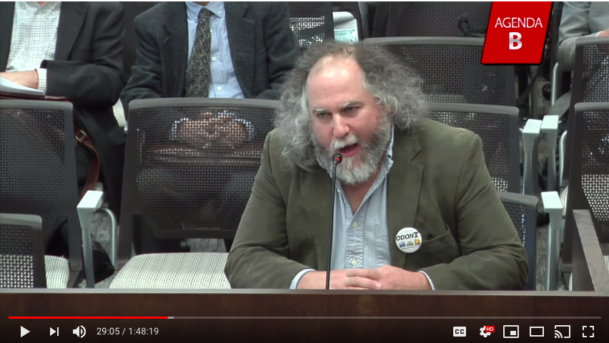 image shows Bob Sallinger of Portland Audubon Society testifying at OTC hearing