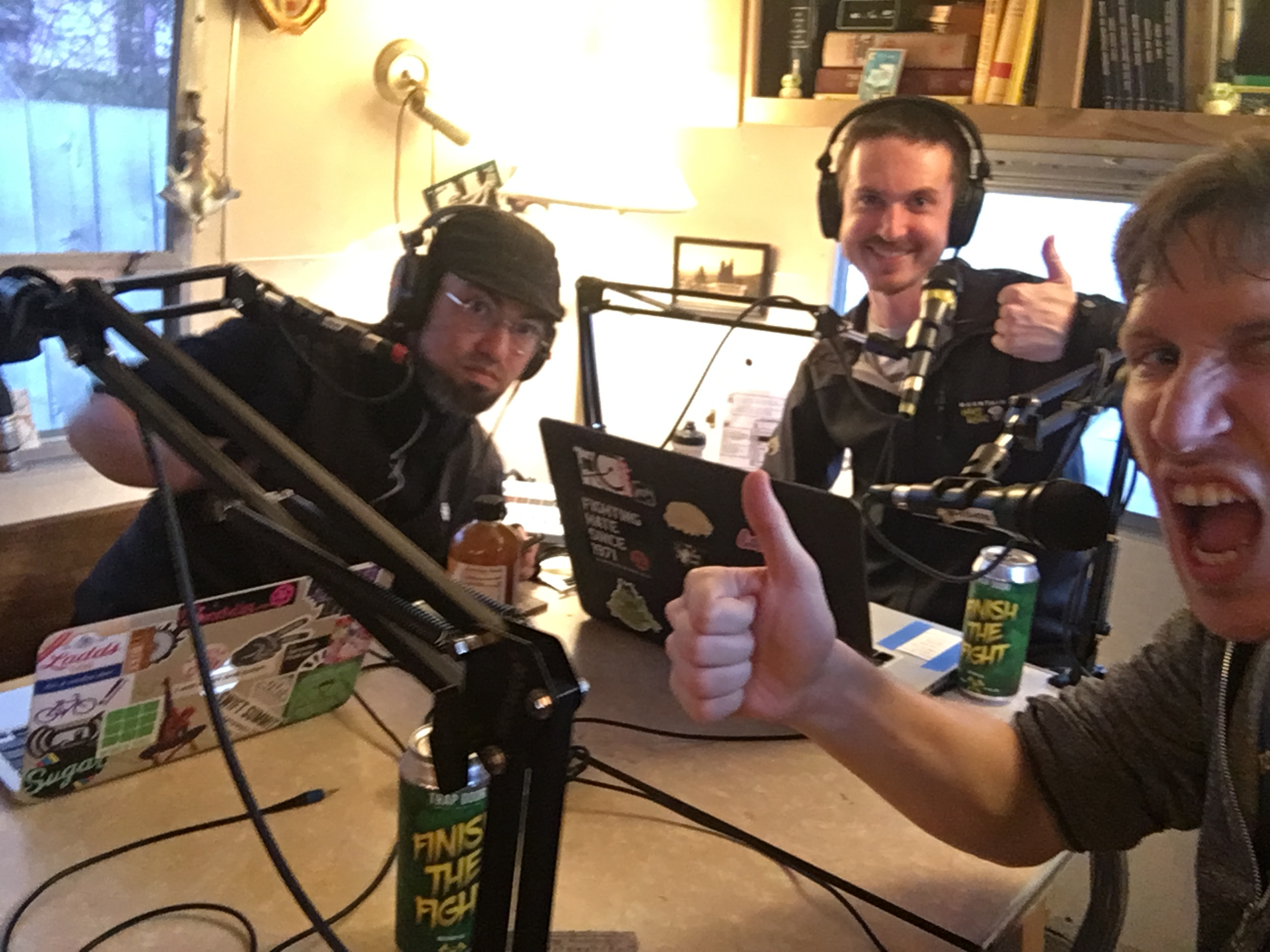 Photo shows a bunch of dudes giving thumbs up while recording the Sprocket Podcast