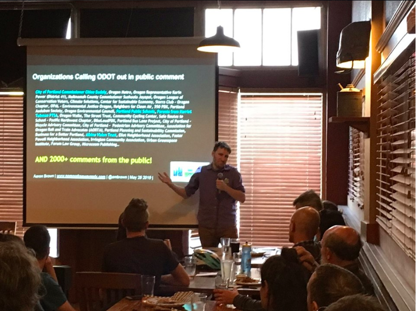 Image shows NMF's Aaron Brown speaking at the Portland Forward Transportation Event this summer.