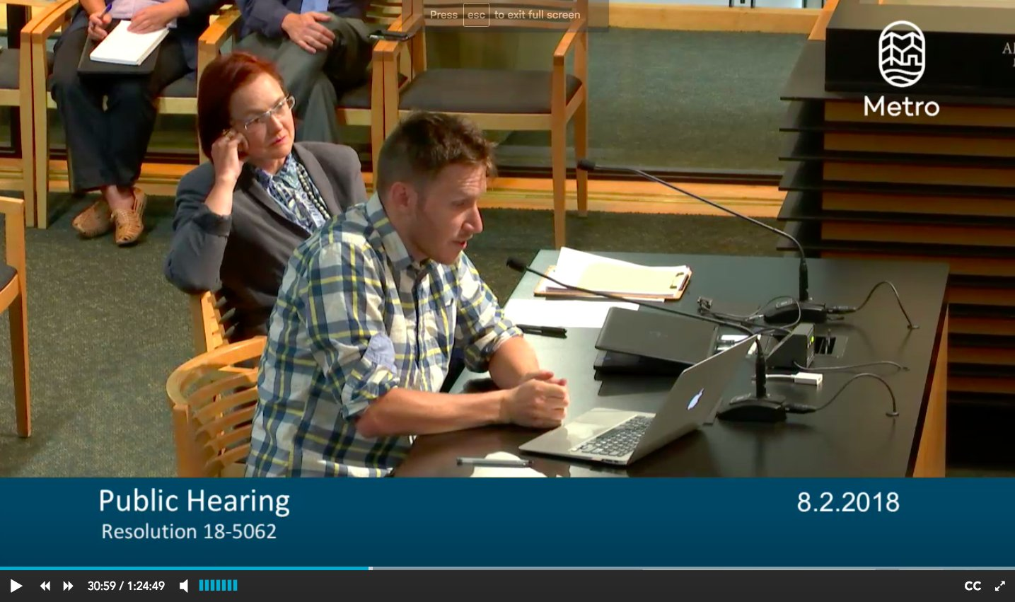 Photo Caption: Aaron Brown and Sarah Iannarone testifying at a Metro Council meeting this August.