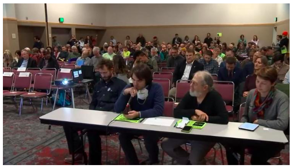 Photo shows community members testifying in opposition to ODOT's Rose Quarter Freeway Expansion at their public hearing last March.
