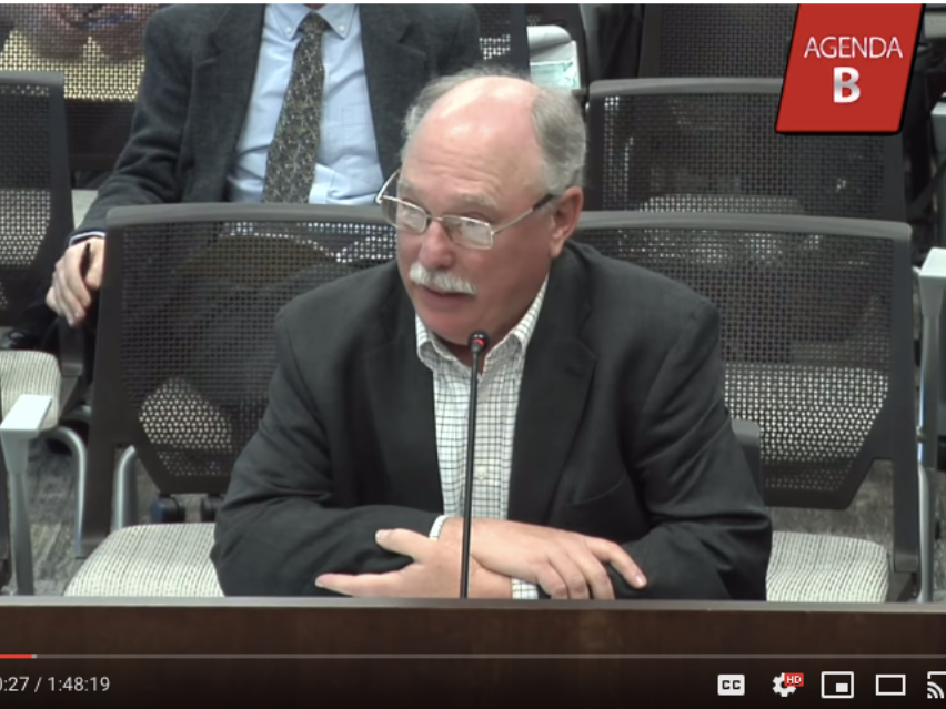 image shows Joe Cortright, testifying at an OTC meeting this summer.