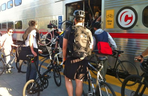 Bicyclists board rail transit car